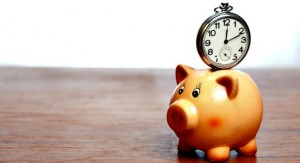 Retro pocket watch on a piggy bank